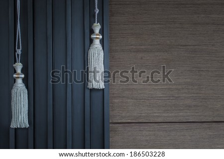 Curtains in classic interior, wooden background - stock photo