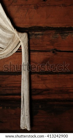 Curtains on old timber wall in abandoned farm house in Southern Finland. - stock photo