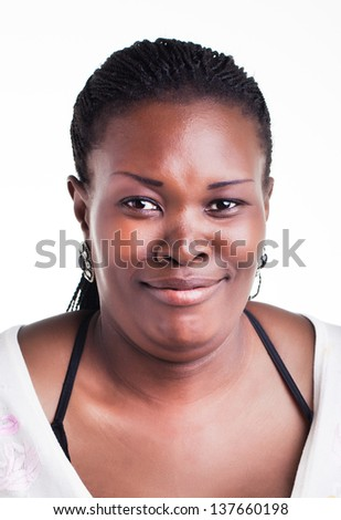 curvaceous african woman with an amusing frown like facial expression - stock photo