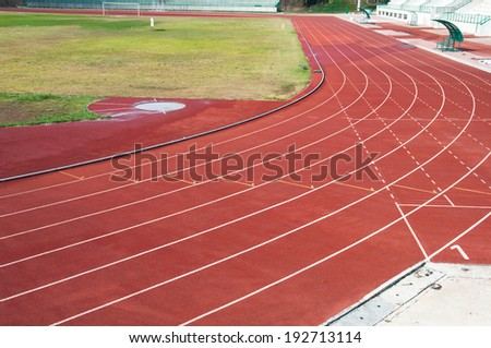 Curve and line on running track with texture rubber cover - stock photo