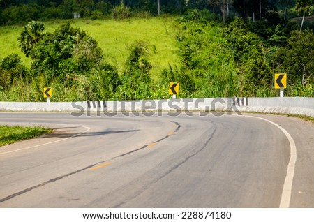 Curve mountain road in nature - stock photo