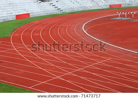 Curve of Race Track in Big Football Stadium - stock photo