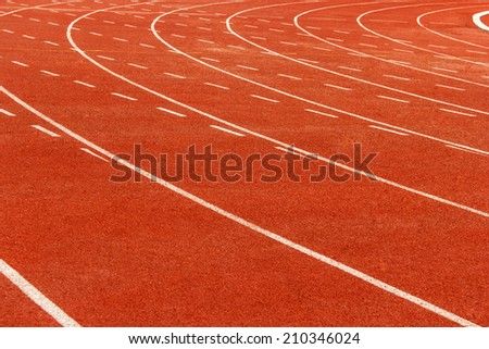 Curve of running track background. - stock photo