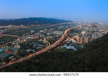 Curve of the highway and Taipei Urban Landscape - stock photo