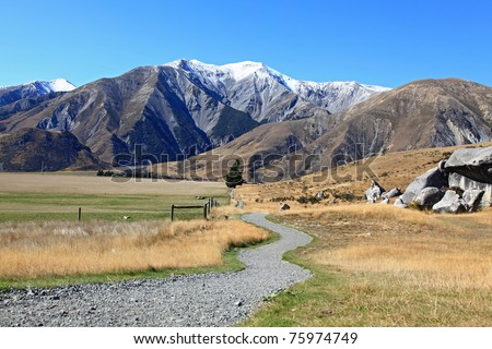 curve pathway to the mountain at Castle Hill New Zealand - stock photo