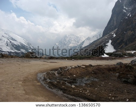 Curve Road to hill top of Yumesamdong (Zero Point) in Lachung, North Sikkim.  - stock photo