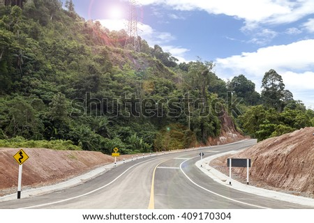 Curve Roads Sky background with lens flare - stock photo
