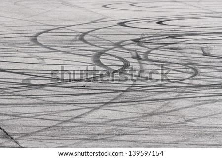 Curve tyre marks on an asphalt surface - stock photo