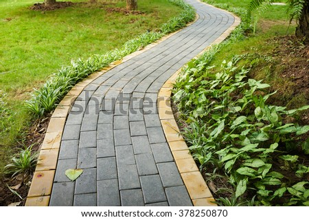 Curve walking path in park - stock photo