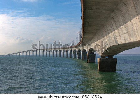 Curved Concrete Bridge over the water. Horizontal shot - stock photo