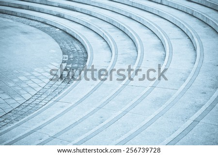 Curved concrete steps as an abstract image in blue tones - stock photo