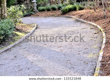 Curved gravel road in the forest