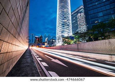 curved light trails on the city road in guangzhou