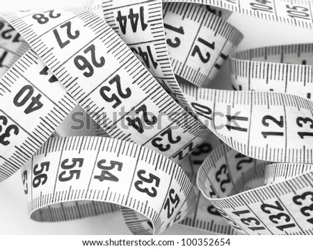 curved measuring tape - stock photo