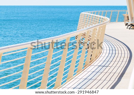 curved metal white painted railing detail of Lido di Camaiore's pier