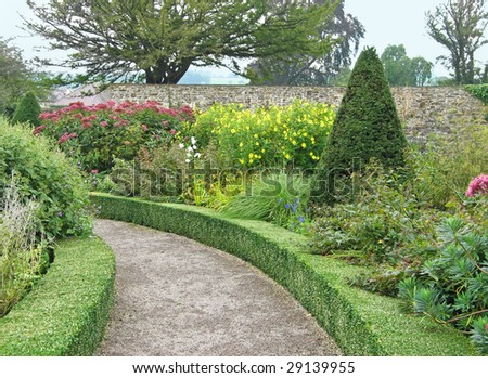 Curved path in walled garden at Aberglasney, Wales, UK