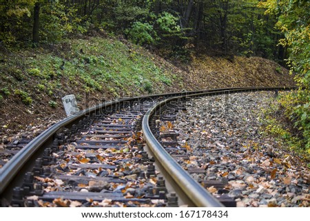 Curved railway track - stock photo