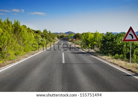 Curved road in the mountain - stock photo