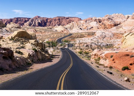 Curved road through rocky desert in Valley of Fire State Park, Nevada.