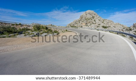 Curved road to heaven - stock photo