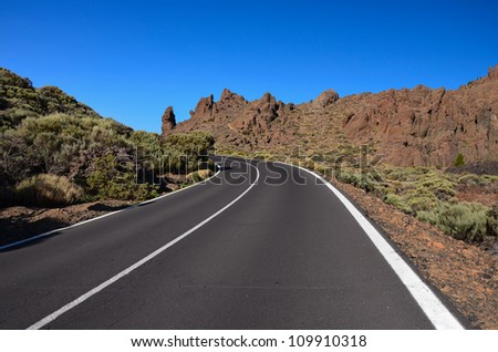 Curved tarmac road in Teide National Park, Tenerife, Canary Islands, Spain - stock photo