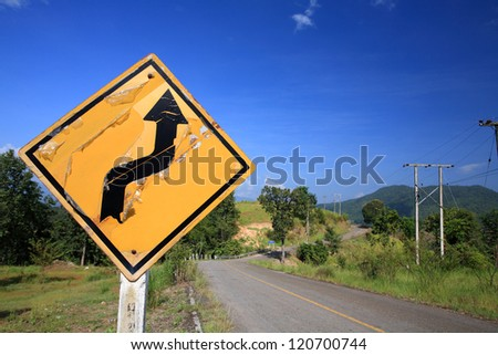 Curved Traffic sign on local street - stock photo