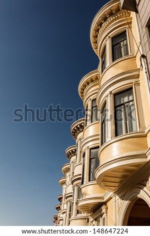 Curved windows of San Francisco row houses seen from side - stock photo