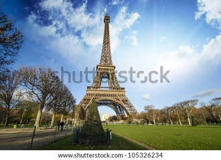 Curves of the Eiffel Tower under blue sky at shiny Winter morning, Paris - stock photo