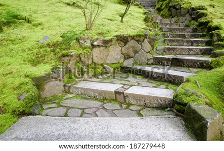 Curving stone stairway with surrounding moss covered grounds - stock photo