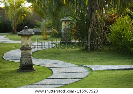 Curving traditional garden path in Bali, Indonesia - stock photo