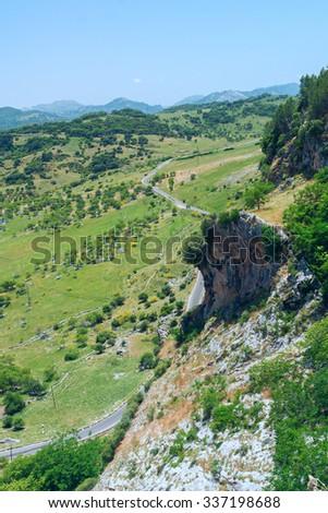 Curvy narrow roads in Spain - stock photo
