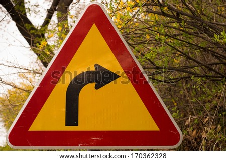 Curvy road sign in the park - stock photo