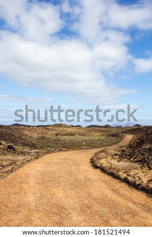 Curvy trail on the small island of Los Lobos, near Fuerteventura, in the Canary Islands, Spain. - stock photo
