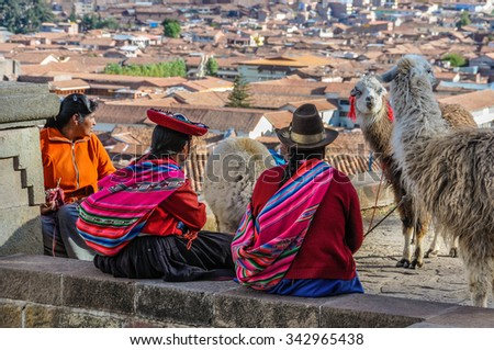 CUSCO, PERU - MAY 25, 2012: Old ladies with lamas in the capital of Incas, Cusco, Peru