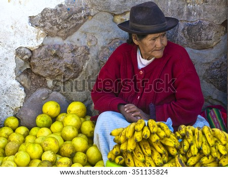 CUSCO , PERU - MAY 27 : Peruvian woman selling fruits at the San Pedro Mercado Central in Cusco Peru on May 27 2011 San Pedro is the biggest open-air market in Cusco