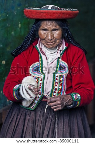 CUSCO, PERU- MAY 26: Quechua Indian woman weaves with a strap loom in Cusco ,Peru on May 26 2011, Quechua weavers known worldwide for their skills and rich traditions. - stock photo
