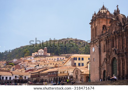 Cusco, Peru - September 9, 2015: People and tourists walking in the streets of Cusco, former Inca capital, famous travel destination in Peru and one of the most visited historical cities in the world.