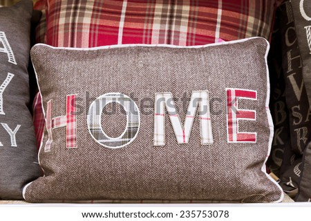 Cushion with home written on it - stock photo