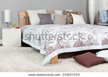 Cushions arranged on bed in room - stock photo