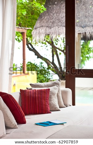 cushions on the sofa in living room of beach villa - stock photo