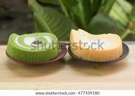 Custard cream and green Tea roll cake on the plate