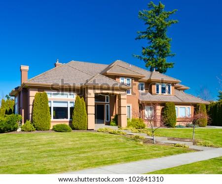 Custom built luxury colorful house in a residential neighborhood. - stock photo
