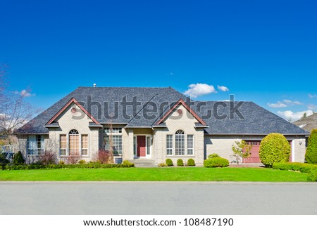 Custom built luxury house in a residential neighborhood. - stock photo