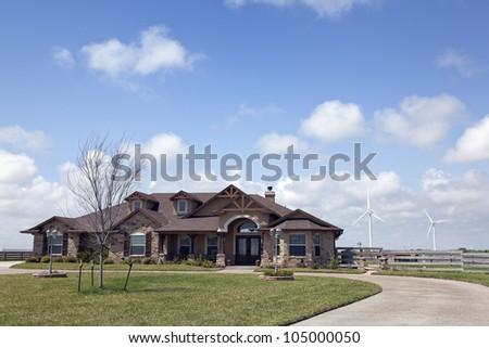 Custom Built Luxury House with Power Generating Turbines in the Neighborhood. - stock photo