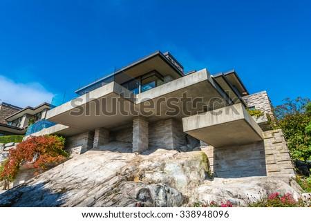 Custom Built Luxury Modern House On Stock Photo - Modern house on cliff