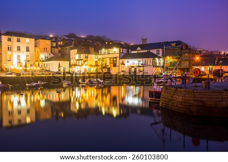 Custom House quay harbour Falmouth at Dusk on a foggy evening. Cornwall England UK Europe - stock photo