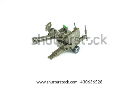 Custom made anti-aircraft gun weapon toy. Isolated on white background. Slightly de-focused and close-up shot. Copy space. - stock photo