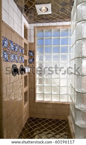 Custom shower with specialty tile and window blocks for lots of natural light. - stock photo