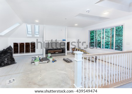 Custom stair rails, balusters and remaining skylights installed - stock photo