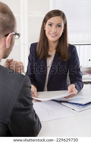 Customer and agent sitting at desk in a meeting or successful collaboration under man and woman in the office. - stock photo